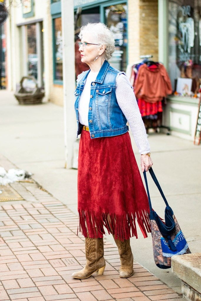 Wearing country western attire with a denim vest