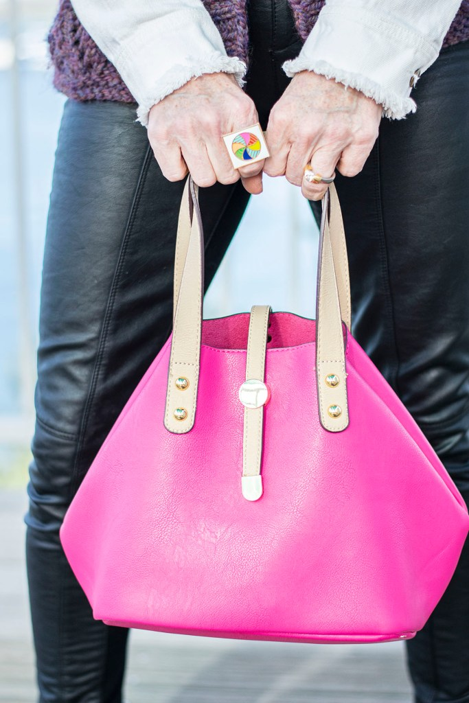Pink purse as a pop of color