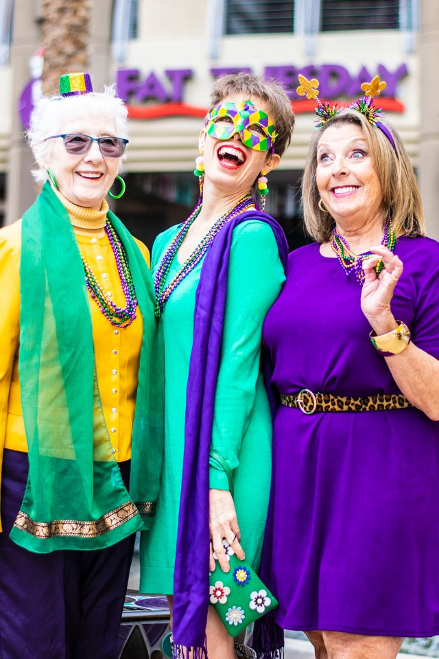 Party time wearing Mardi Gras colors