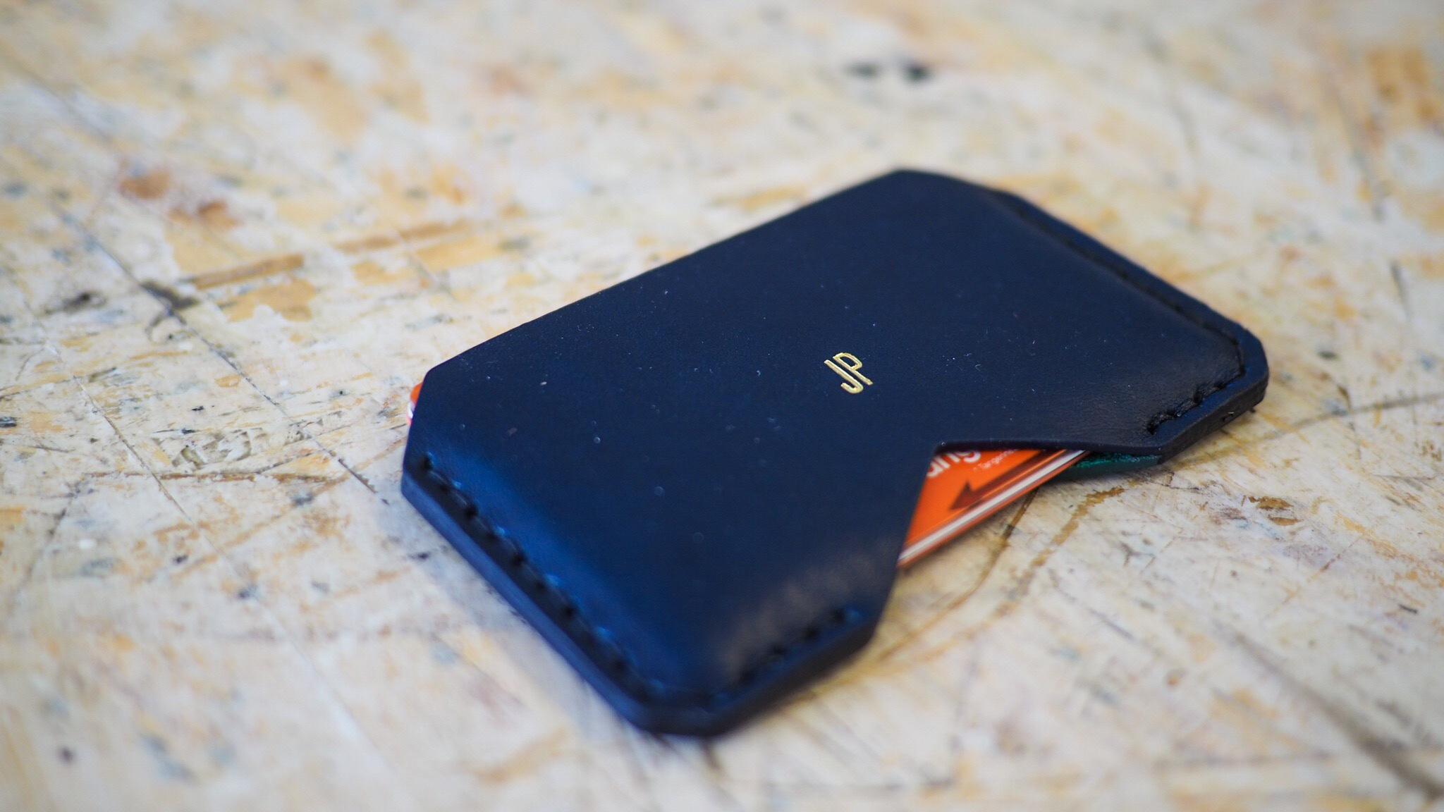 A Montreal Airbnb Experience with Lajoie creating a custom leather cardholder