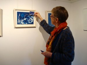 the artist at the exhibition with her work