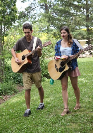 Roving musicians 'Two-Sided', (Steph and Jack) delighting our guests in the garden!