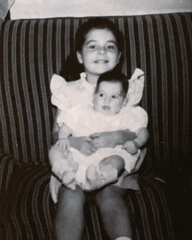 Donna holding Linda