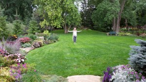 Nina in Sharon's spectacular garden. Can you tell Nina is a yoga instructor?
