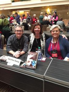 At the author signing with Art Taylor, winner of the Agatha Award for Best First Novel, and Harriet Sackler, Malice Grants Chair.
