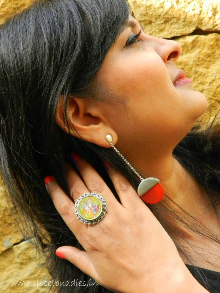 The Silver hand-painted ring is from Amrapali