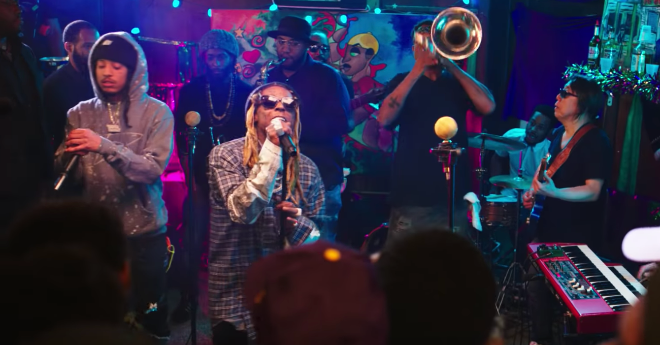 "Lil Wayne Feat. Poppy H, Corey Henry & The Treme Funktet – ""Playoff"" (Video)"
