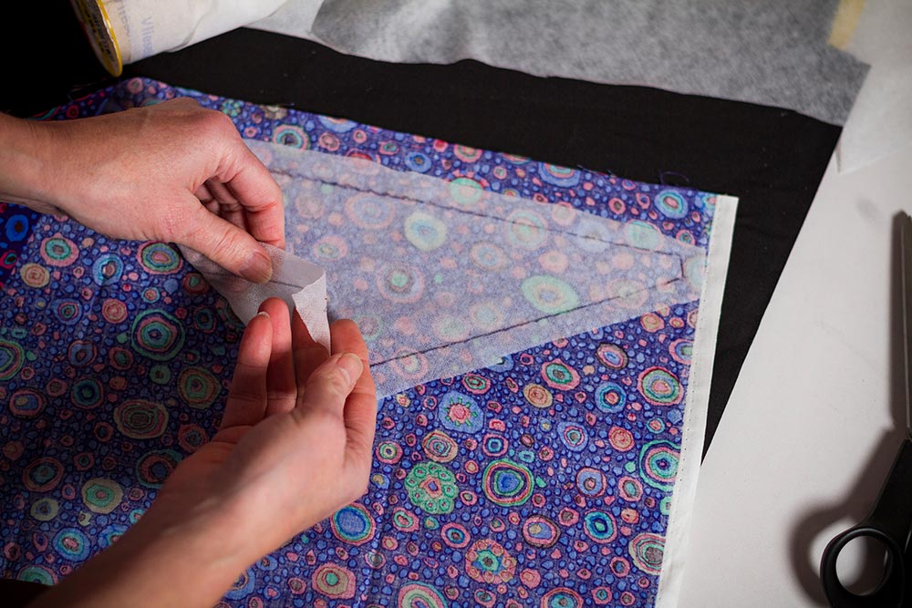 arrange the Vilene on the back of the Fabric