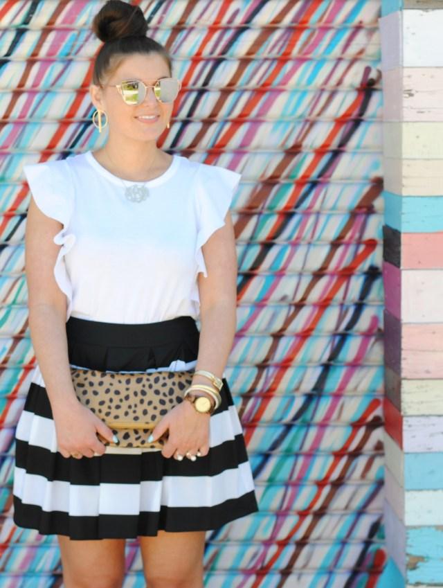 Black and White Stripe Skirt. Pom Pom Sandals, Leopard Clutch.