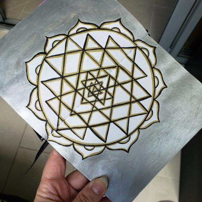 silver and gold painted mandala