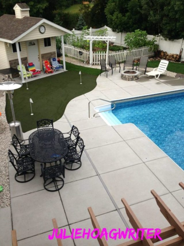 Deck view of pool, shed, firepit