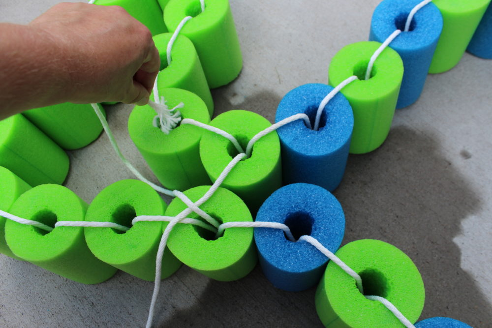 cross rope and thread rope through the next green noodle on the opposite side