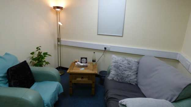 photo of location Ellesmere Port counselling room showing comfortable chairs and a coffee table