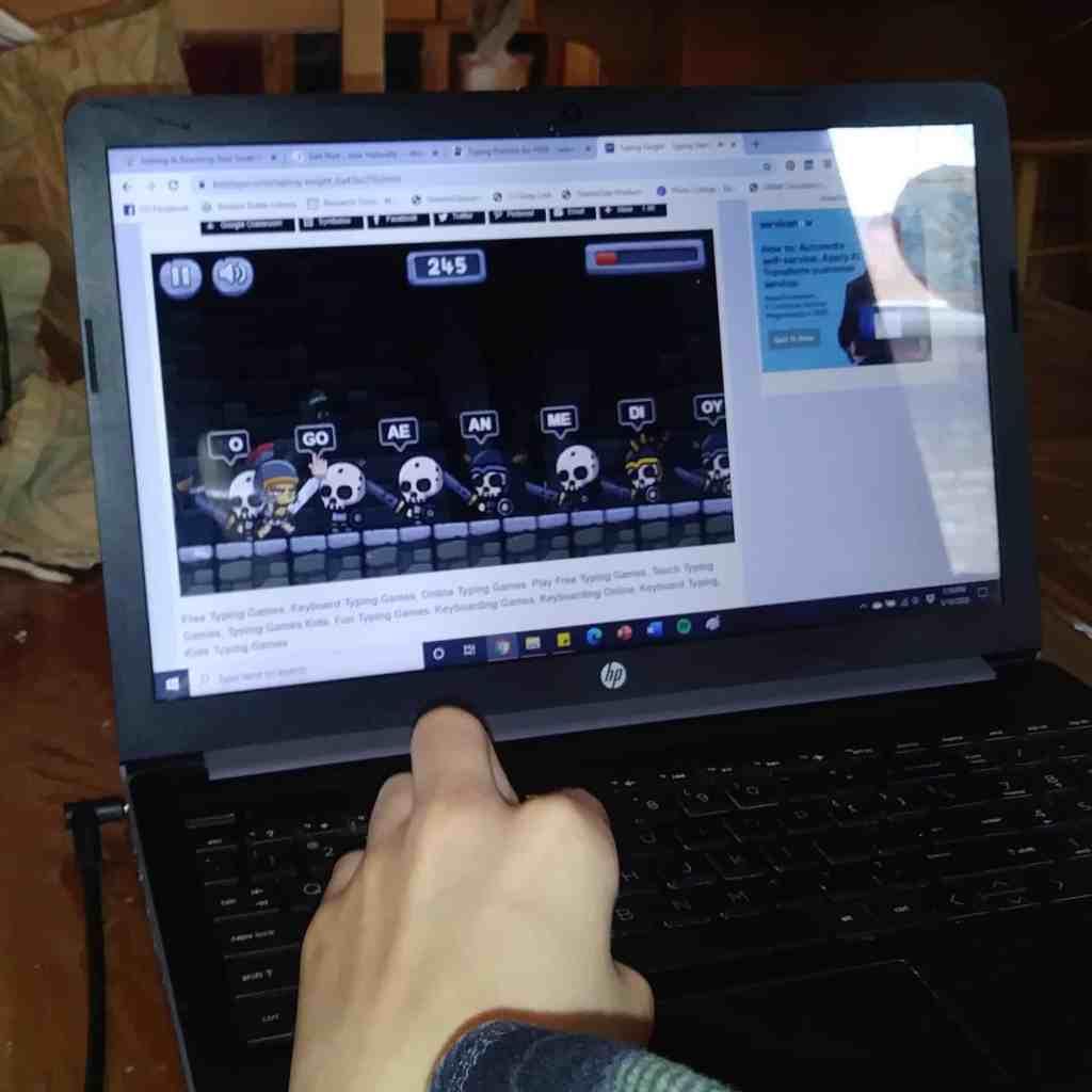 child playing free typing games at TypeDojo.com