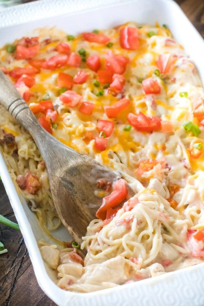 Mexican Chicken Spaghetti with spoon in casserole dish