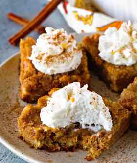The Ultimate Pumpkin Bars! ~ Delicious Cake Batter Crust, Dreamy Pumpkin Pie Filling Topped with a Delicious Cake Topping! Ditch the other Pumpkin Bar Recipe, Because It's Been Replaced!
