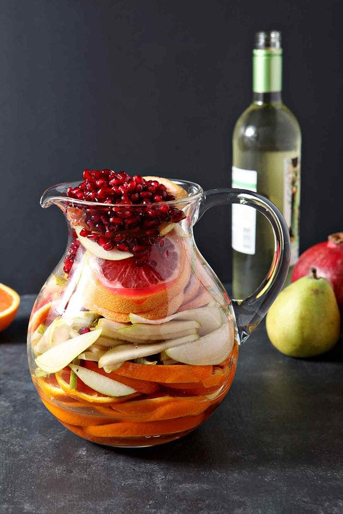 Full of pink grapefruit, cara cara or blood oranges, pears and pomegranates, Winter Sangria is bursting with flavor.