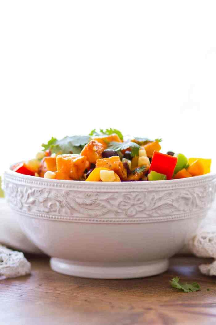 Side view of Sweet Potato Salad Recipe in white bowl