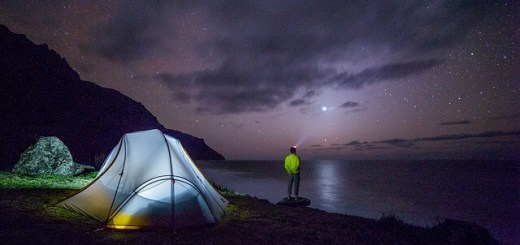 A man watching night sky from his camping trip