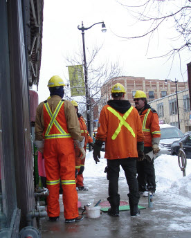 Toronto Hydro workers check handwells in the Junction
