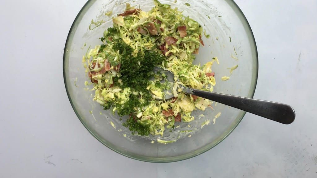 Here's another beautiful brussel sprouts recipe: a crunchy shredded brussel sprouts slaw with croutons, grated parmesan cheese and crispy bacon bits!