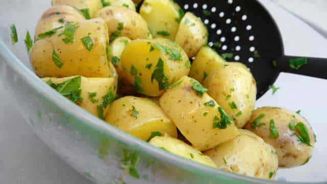 My drop dead simple classic potato salad recipe with olive oil and lots of fresh herbs and capers: a light potato side dish!