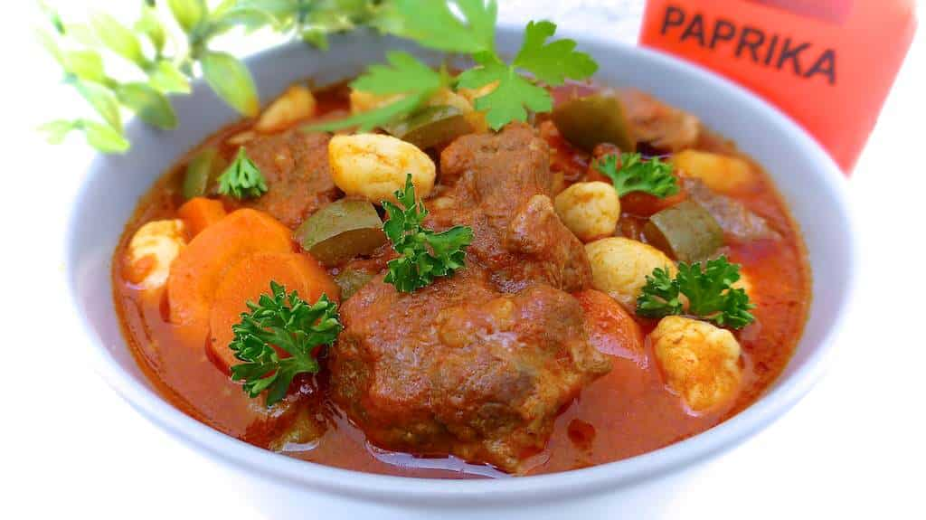 Here's my recipe for goulash: a rich beef soup with ground paprika, tomatoes, potatoes and bell peppers... A classic Hungarian dish!