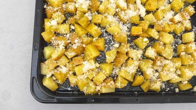 My delicious parmesan potatoes: look at that crunchy golden crust! These are to die for: cheesy fried potato bits baked in the oven.