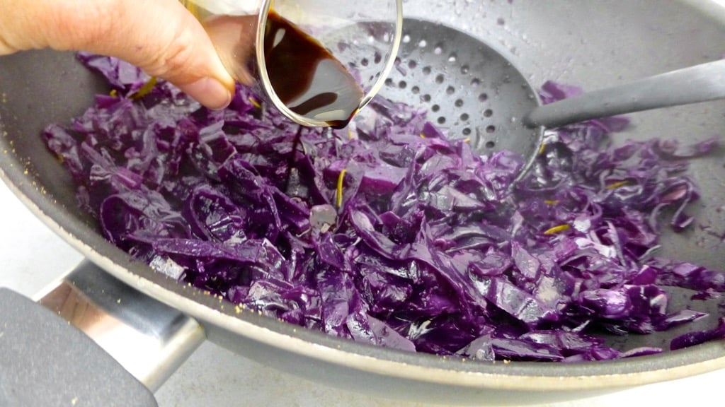 Sliced red cabbage in flavorful kriek beer: what an amazing flavor match this is! Try out this braised red cabbage recipe...