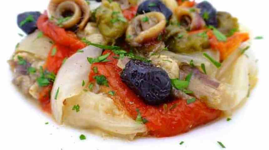 Spanish escalivada: a bunch of roasted onions, eggplant and bell pepper, a savory Catalonian specialty that melts in your mouth.