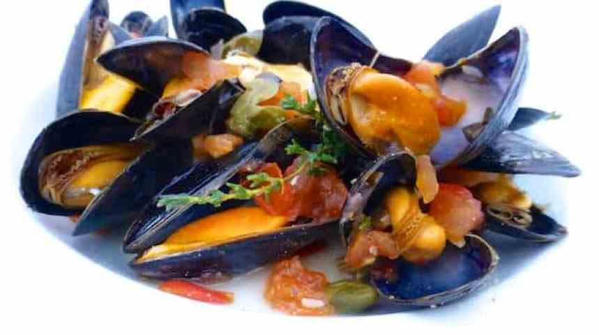 My delicious mussels provencal recipe with fresh tomatoes, black olives, capers, garlic and white wine... Awesome summer meal!