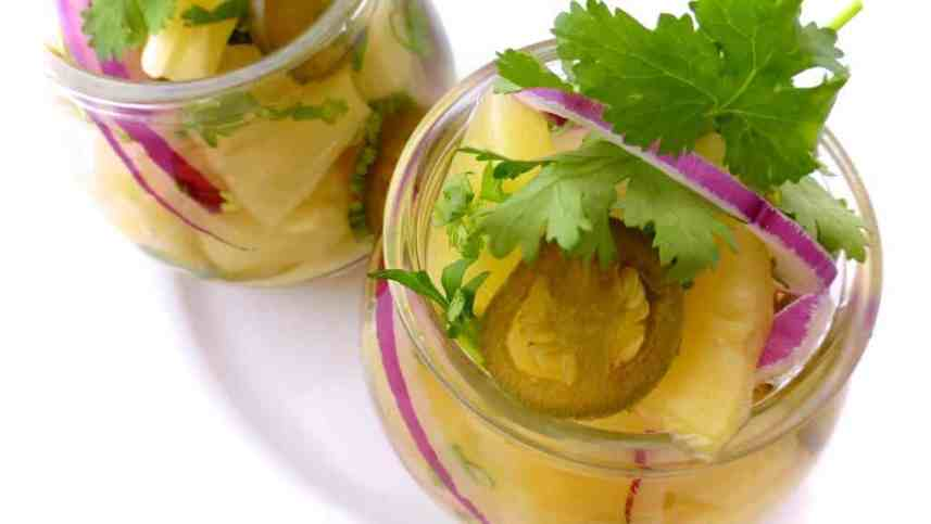Got leftover pineapple? Make this spicy pickled pineapple with jalapeño and cilantro! Lovely in combination with cold cuts, cheese or roast dinners.