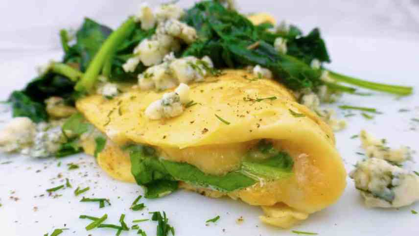 Here's a quick and easy spinach omelette with gooey stilton blue cheese and garlicky spinach... What a great breakfast or brunch recipe idea!