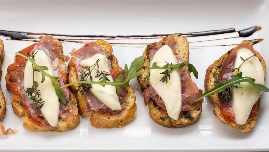 Here's a classic summer appetizer: my Italian bruschetta recipe. Plain and simple diced tomatoes with fresh basil on grilled bread crostini. Light and healthy!