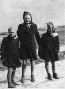 June (middle) with her twin sisters