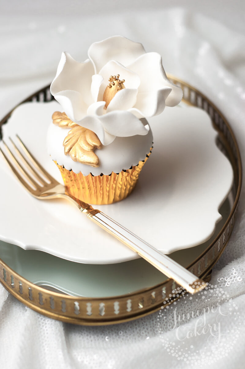 Gold magnolia cupcake by Juniper Cakery