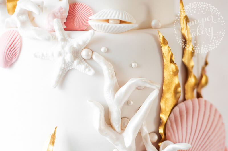 Gold see themed wedding cake by Juniper Cakery