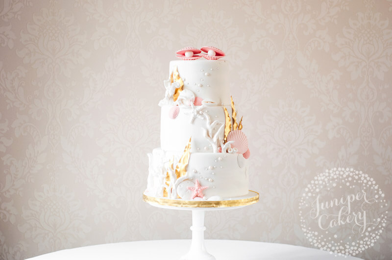Lovely pink sea themed wedding cake by Juniper Cakery
