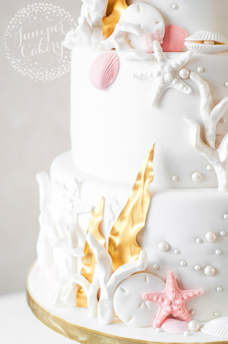 Pink and gold under the sea wedding cake by Juniper Cakery