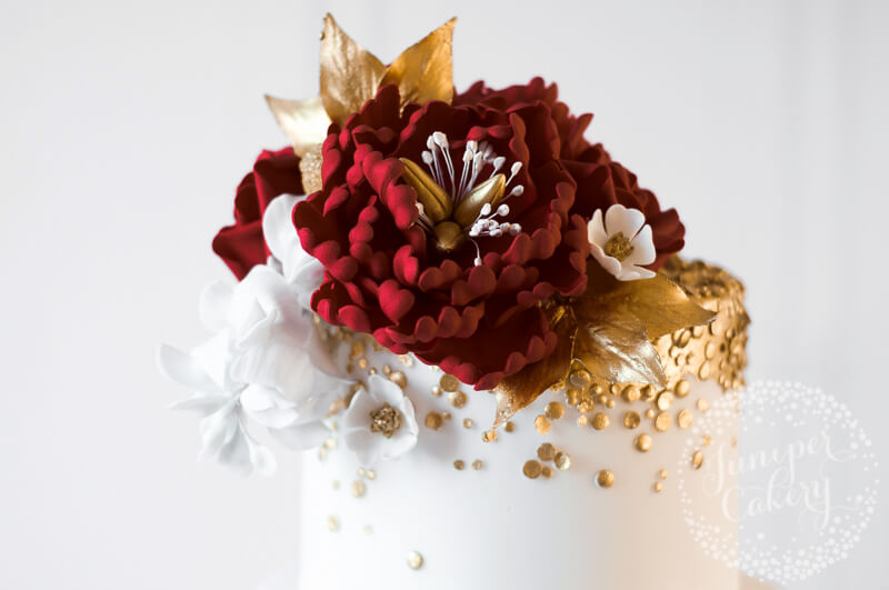 Red, gold and white Indian wedding cake by Juniper Cakery