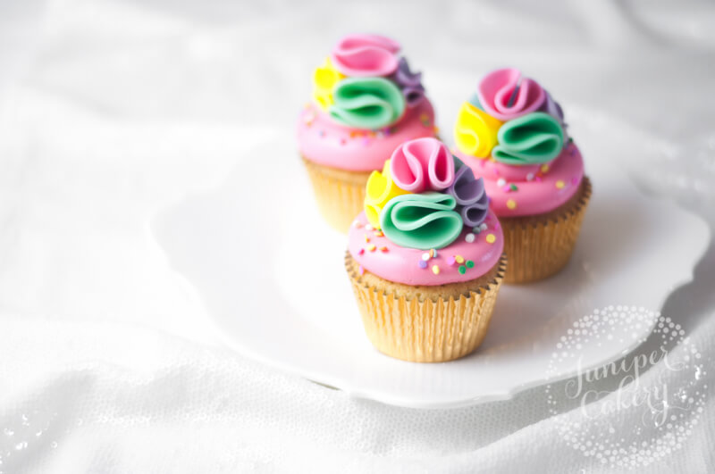 Rainbow pom pom cupcakes by Juniper Cakery