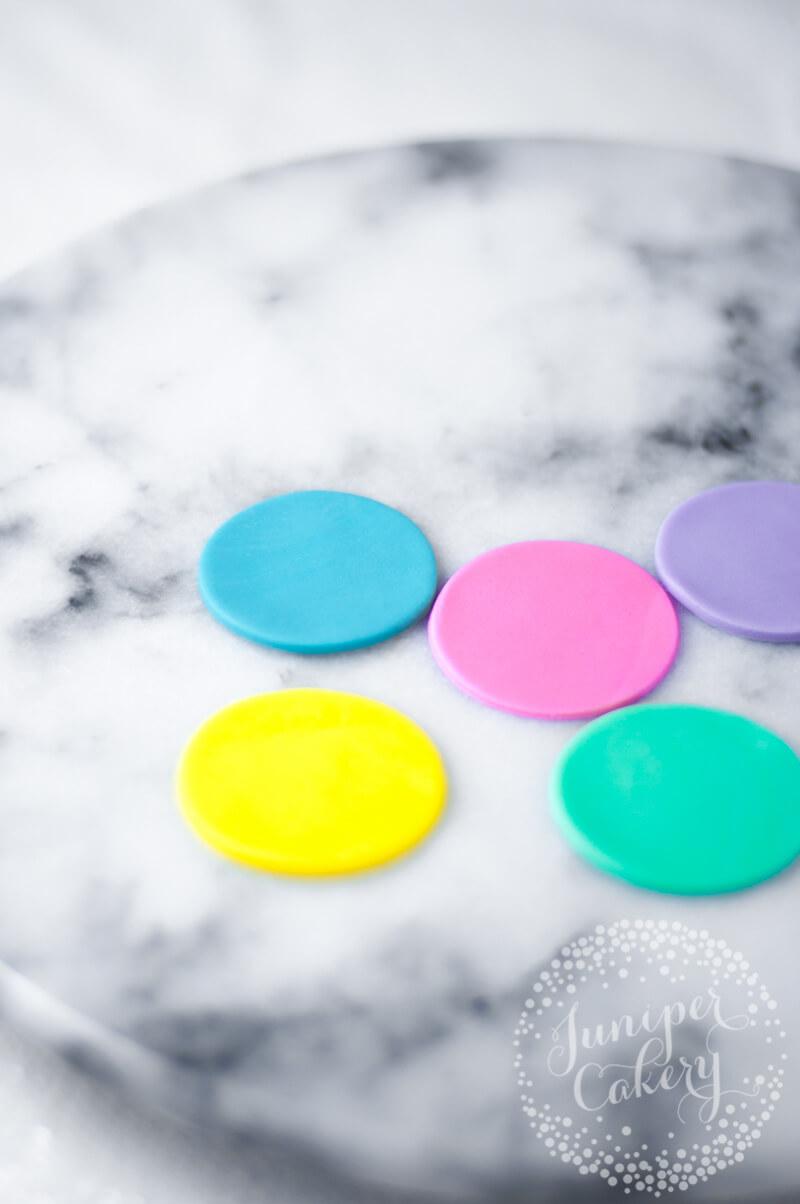 Fondant rainbow pom pom cupcakes tutorial form Juniper Cakery