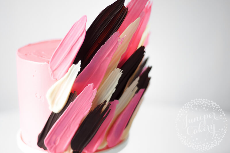 Bright pink brushstroke cake tutorial by Juniper Cakery