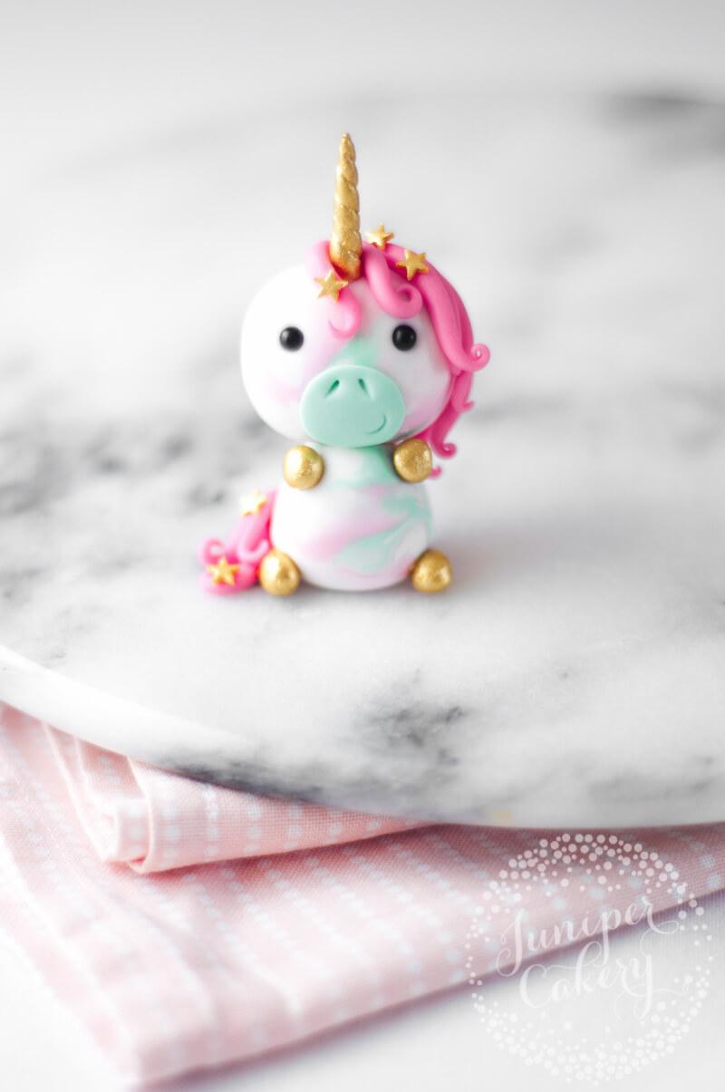 Adorable little unicorn cupcake topper tutorial from Juniper Cakery