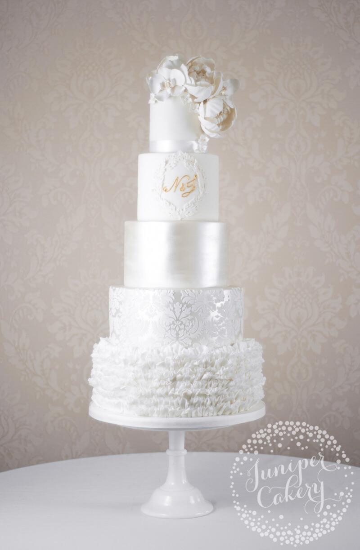 Grand white on white wedding cake at rise hall juniper cakery glamorous and grand white wedding cake by juniper cakery junglespirit Image collections