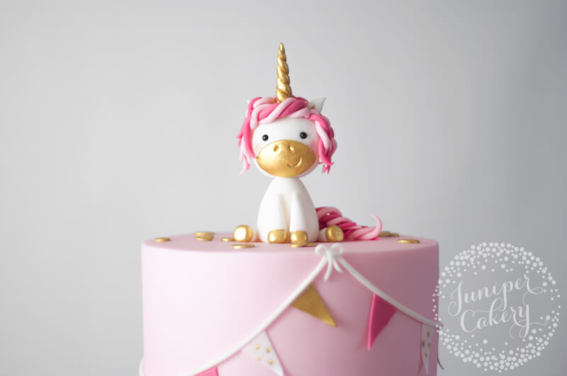 Pink unicorn Christening cake by Juniper Cakery