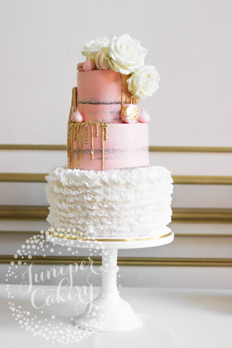 Blush pink semi-naked wedding cake with white fondant ruffles by Juniper Cakery
