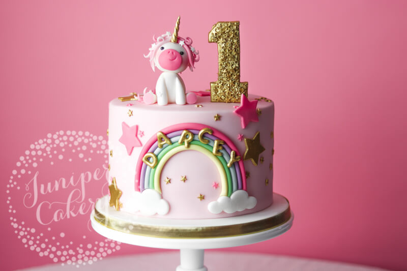 Pink unicorn cake with stars by Juniper Cakery