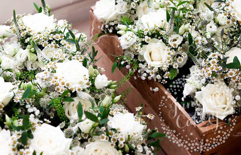 White wedding florals by The Wedding and Flower Boutique