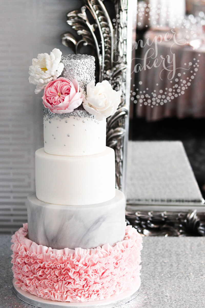 Glam pink ruffle and grey marble wedding cake by Juniper Cakery